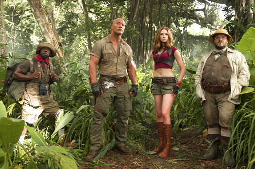 """FILE - This file image released by Sony Pictures shows Kevin Hart, from left, Dwayne Johnson, Karen Gillan and Jack Black in Jumanji: Welcome to the Jungle. Columbia Pictures says Sunday, Jan. 7, 2018, that the Johnson-led """"Jumanji"""" is estimated to have earned an additional $36 million, bringing its total to $244.4 million. (Frank Masi/Sony Pictures via AP, File)"""