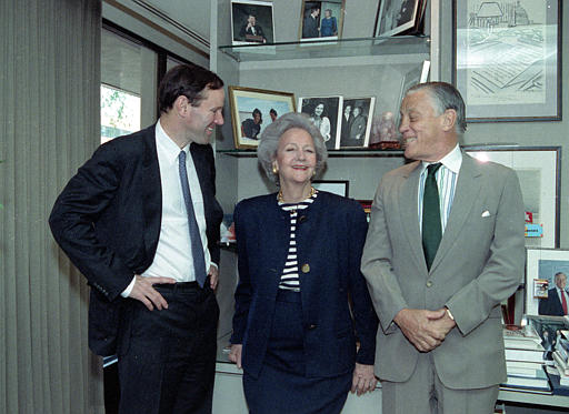 Katharine Graham, Chairman of the Washington Post poses with her son publisher Donald Graham, left, and Ben Bradlee, executive editor of the post, in her office in New York City on Wednesday, May 8, 1991.  (AP Photo/Dennis Cook)