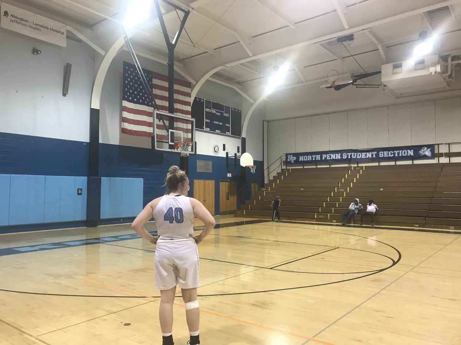 BASKETBALL- Senior Jess McKenzie reflects on the court after her team's twelfth loss in a row.