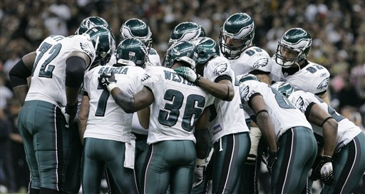 Members of the Philadelphia Eagles huddle during the first quarter of the NFC divisional playoff football game against the New Orleans Saints at the Louisiana Superdome in New Orleans, Saturday, Jan. 13, 2007. (AP Photo/Bill Haber)