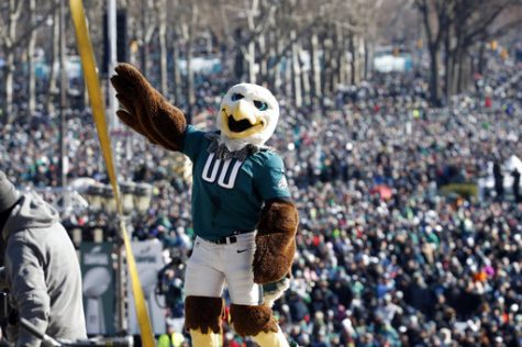 "Philadelphia Eagles mascot ""Swoop"" reacts with the fans behind him in front of the the Philadelphia Museum of Art after a Super Bowl victory parade for the Philadelphia Eagles football team, Thursday, Feb. 8, 2018, in Philadelphia. The Eagles beat the New England Patriots 41-33 in Super Bowl 52. (AP Photo/Alex Brandon)"
