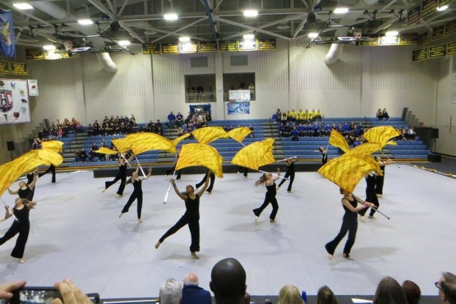 The Color Guard portraying their story, Operation Pied Piper, at the Spring-Ford High School
