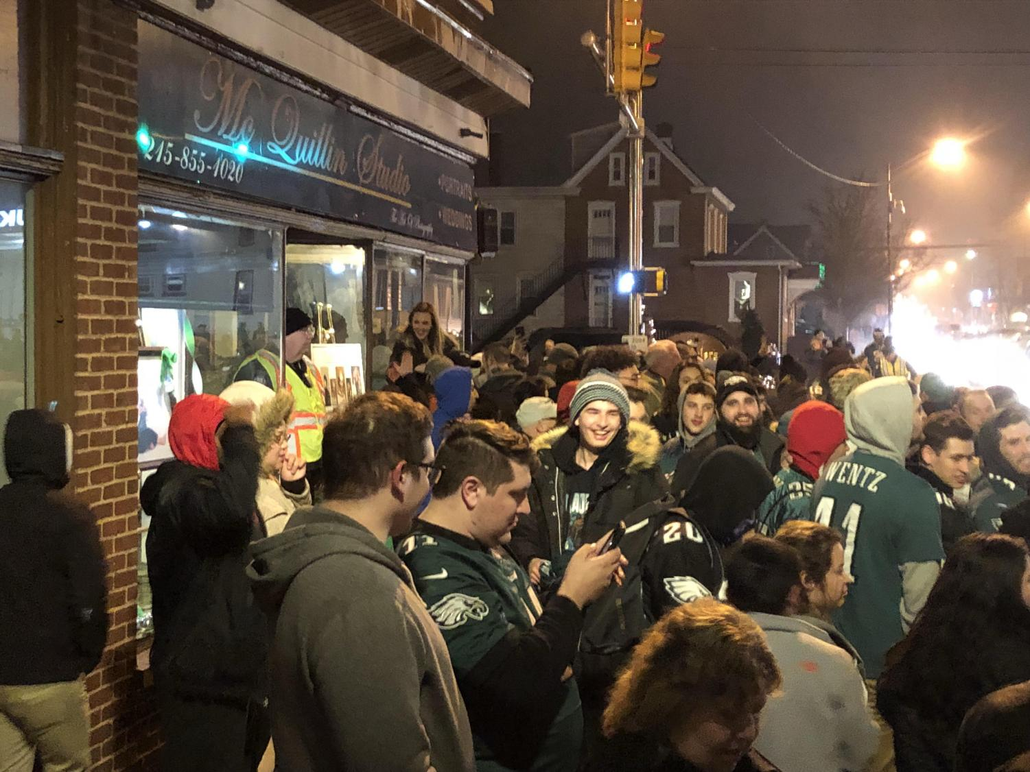 Super Celebration! Lansdale residents pour into the sidewalks at Main and Broad late Sunday night to celebrate the Eagles first Super Bowl title in history.