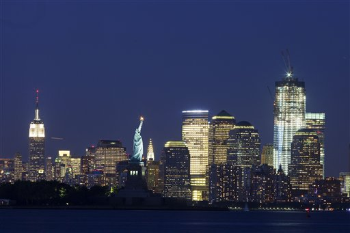 The Empire State Building, left, the Statue of Liberty, center, and One World Trade Center, right, are part of the New York skyline, Tuesday, Aug. 23, 2011. (AP Photo/Mark Lennihan)