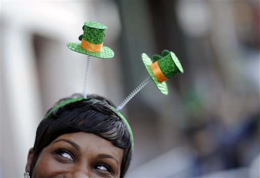 Krystal Thomas of Atlanta parties on River Street while wearing a shamrock headband during the 189th St. Patrick's Day celebration, Friday, March 15, 2013, in Savannah, Ga. (AP Photo/Stephen Morton)