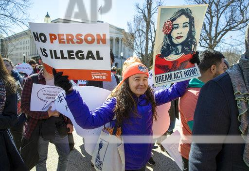 DACA recipients and other young immigrants march with supporters as they arrive at the Capitol in Washington, Monday, March 5, 2018. The program that temporarily shields hundreds of thousands of young people from deportation was scheduled to end Monday by order of President Donald Trump but court orders have forced the Trump administration to keep issuing renewals, easing the sense of urgency.  (AP Photo/J. Scott Applewhite)