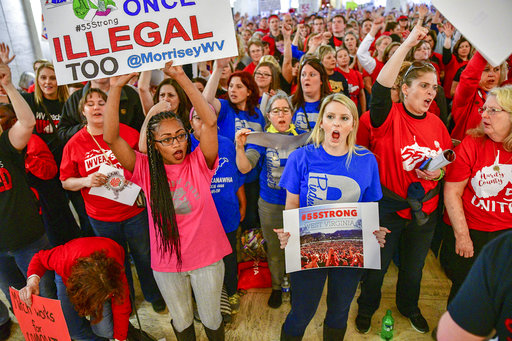 Teachers hold a rally outside the Senate Chambers in the West Virginia Capitol Monday, March. 5, 2018 in Charleston, W.V. Hundreds of teachers from 55 counties are on strike for pay raises and better health benefits,  (AP Photo/Tyler Evert)