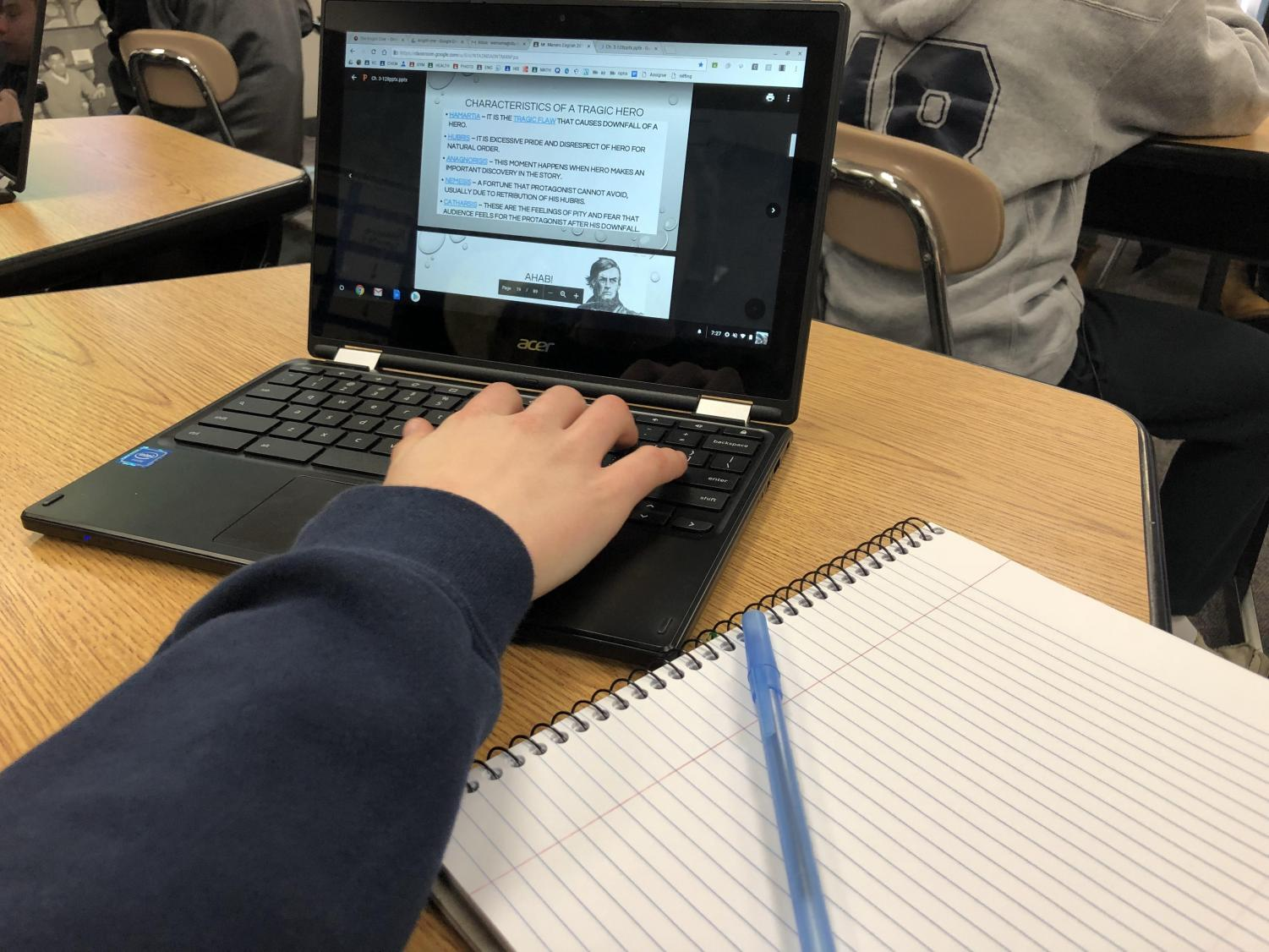 Chrome v. Pen: A North Penn High School student scrolls through an English class power point on Moby-Dick. With an increase in technology in the classroom comes a decrease in hand written note taking. Whether that change is for better or worse is up for debate among educators.