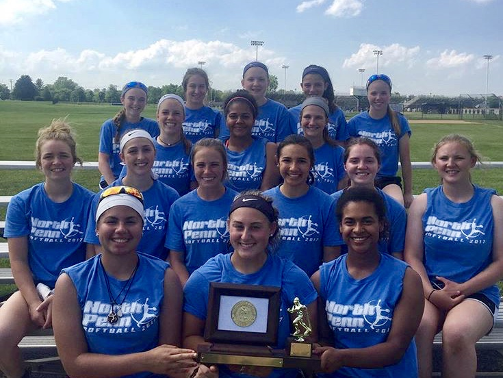 SOFTBALL-+The+2017+softball+team+poses+with+a+trophy.