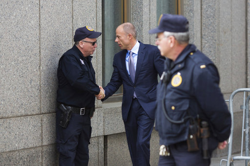 Attorney Michael Avenatti, who is representing Stormy Daniels, arrives at federal court on Friday, April 13, 2018, in New York.  A  hearing has been scheduled before U.S. District Judge Kimba Wood to address President Donald Trump's personal attorney, Michael Cohen's request for a temporary restraining order related to the judicial warrant that authorized a search of his Manhattan office, apartment and hotel room this week. (AP Photo/Kevin Hagen)