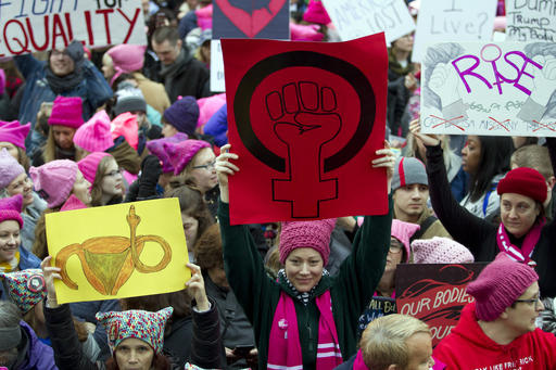 Women with bright pink hats and signs gather early and are set to make their voices heard on the first full day of Donald Trumps presidency, Saturday, Jan. 21, 2017 in Washington.  Organizers of the Womens March on Washington expect more than 200,000 people to attend the gathering.  Other protests are expected in other U.S. cities.  ( AP Photo/Jose Luis Magana)