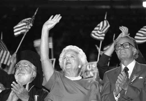 FILE - In this Aug. 18, 1988, file photo, Barbara Bush cheers and waves to her husband, George H.W. Bush, as Rev. Billy Graham, right, stands beside her at the Republican National Convention, in New Orleans. A family spokesman said Tuesday, April 17, 2018, that former first lady Barbara Bush has died at the age of 92. (AP Photo/Tannen Maury, File)