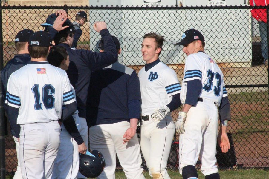 BASEBALL-+The+Knights+congratulate+Zach+Miles+on+his+home+run+as+he+gets+to+home+plate.