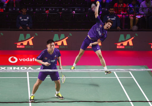 Korean badminton player Lee Long Dae, right, and Malaysian badminton player Tan Boon Heong of Mumbai Rockets play against Indian badminton player B Sumeeth Reddy and Taiwan's badminton player Polish Lee Yang of Chennai Smashers during the Vodafone Premier Badminton League mixed doubles match in New Delhi, India, Wednesday, Dec. 27, 2017. Mumbai Rockets won the match by 15-9, 15-6. (AP Photo/Altaf Qadri)