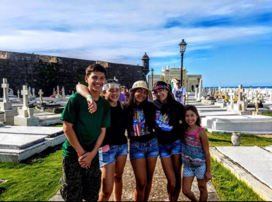 Ramos (far left) poses for a picture with his friends during a four day festival in San Juan, Puerto Rico.
