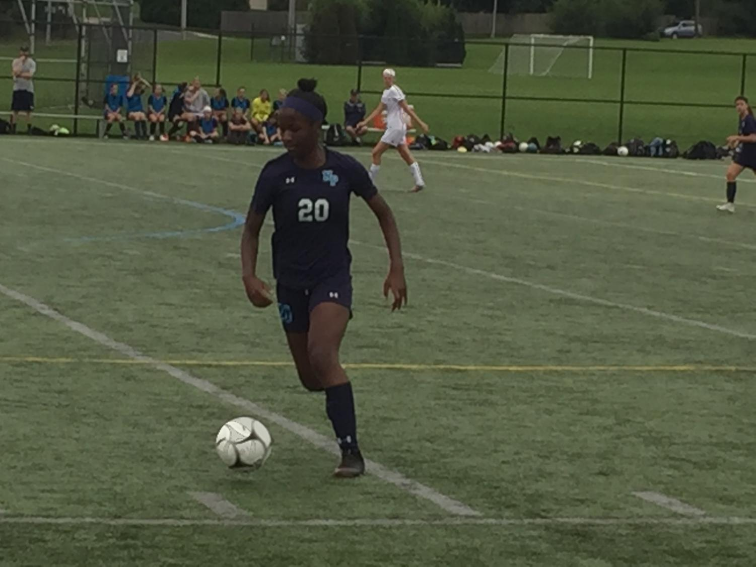 Senior Zoei Baines dribbles  past midfield in a matchup against Souderton