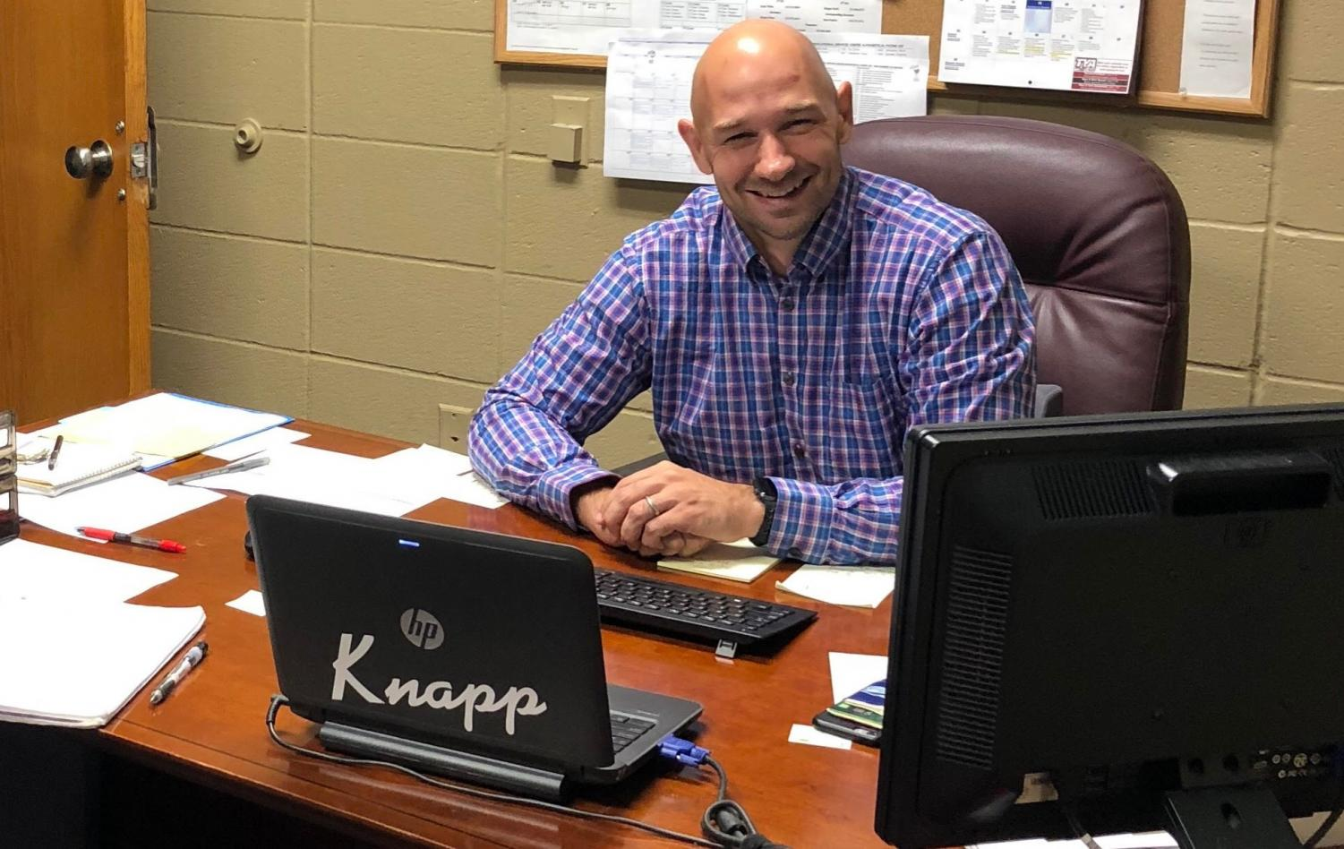 MULLING OVER HIS NEW SCHOOL: Mr. Stefan Muller ease into his new position as principal at Knapp Elementary School