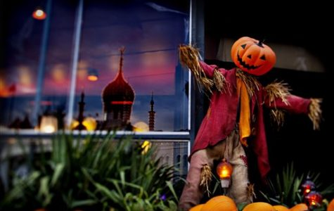 Halloween pumpkins and ghoulish mannequins decorate the amusement park