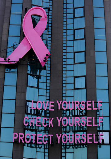 A pink ribbon and a message for breast cancer awareness decorate a building, during a campaign for breast cancer awareness month, in Beirut, Lebanon, Thursday, Oct. 11, 2018. (AP Photo/Hussein Malla)
