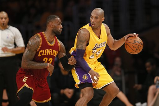 Cleveland Cavaliers' LeBron James, left, defends Los Angeles Lakers' Kobe Bryant, right, during the first half of an NBA basketball game, Thursday, March 10, 2016, in Los Angeles. (AP Photo/Danny Moloshok)