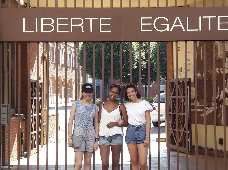 NPHS student Moira Shoush (center) outside of her school, Lycee Ozenne, in Toulouse, France where she studied her junior year as an exchange student.