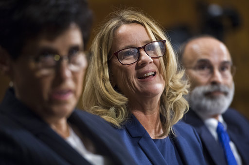 UNITED STATES - SEPTEMBER 27: Christine Blasey Ford, center, flanked by attorneys Debra Katz and Michael Bromwich, testifies during the Senate Judiciary Committee hearing on the nomination of Brett M. Kavanaugh to be an associate justice of the Supreme Court of the United States, focusing on allegations of sexual assault by Kavanaugh against Christine Blasey Ford in the early 1980s. ((Tom Williams/Pool Photo via AP)