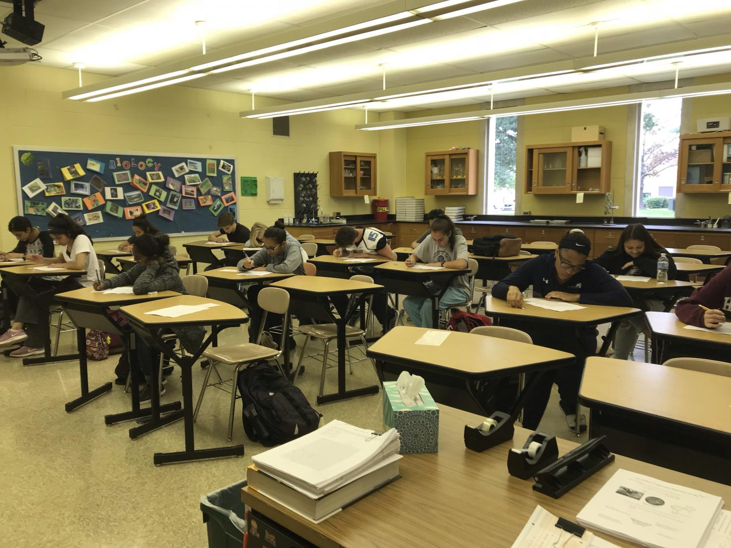 Students at NPHS take a test: Recently with new technology, students have been finding easier ways to cheat and plagiarize on exams and assignments.