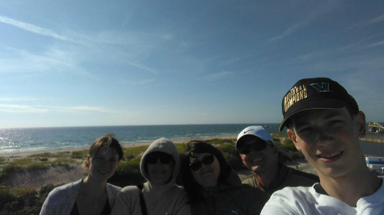 Mindaugas Užkurėnas (far right) and his family on vacation in Latvia.