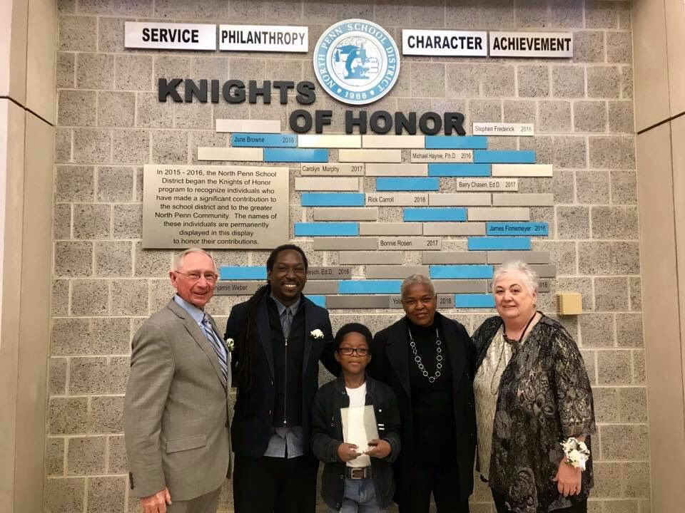 HONOR and INFLUENCE: Rick Carroll (left) Yolanda Wisher (family pictured in center), and and Cindy Louden (right) were inducted into te Knights of Honor class of 2018 on Friday night, October 26, at North Penn High School.