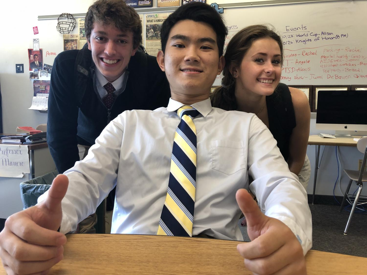 Min Shin, a senior at NPHS, takes time from his academics to pose for a picture with his classmates from public speaking, Kevin Snow and Jess Warner.
