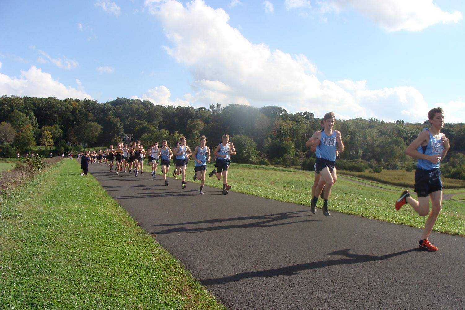 Junior Matt Long leads a pack of blue within the opening mile of the race