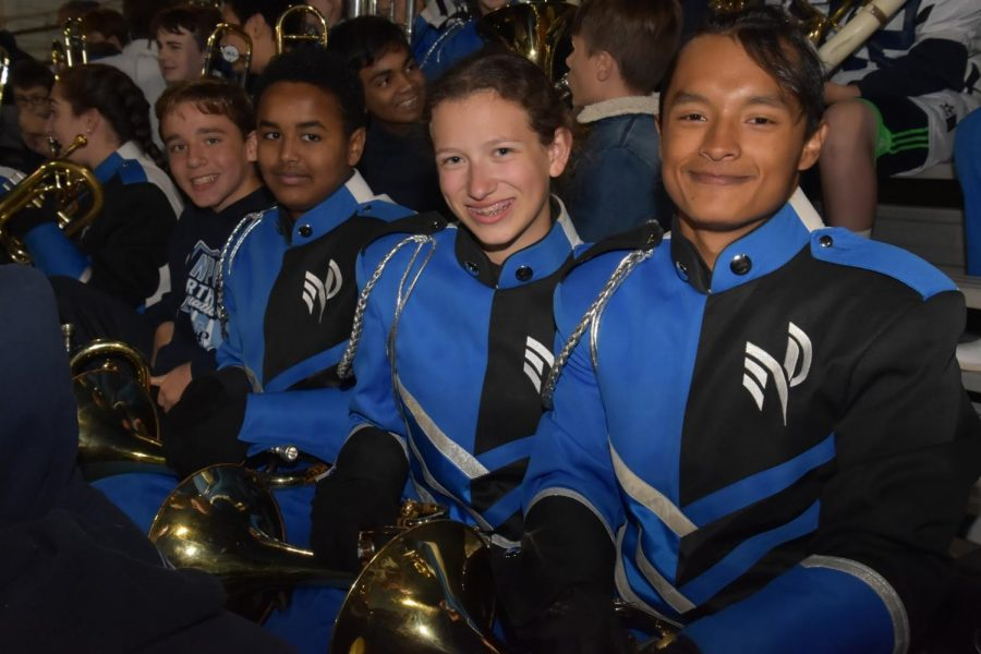 De Jesus (right) with the Marching Knights during a Friday night football game.