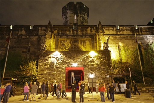 In this Friday, Sept. 27, 2013 photo, Eastern State Penitentiary in Philadelphia is illuminate for its Halloween haunted house Terror Behind the Walls at Eastern State Penitentiary in Philadelphia. The penitentiary took in its first inmate in 1829, closed in 1971 and reopened as a museum in 1994. (AP Photo/Matt Rourke)