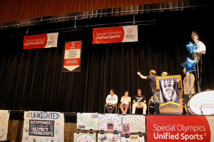 The+Unified+School+banner+makes+it+was+down+in+front+of+the+whole+school.+