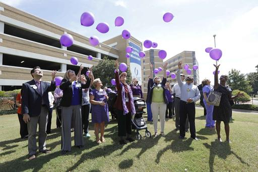 Over 100 balloons bearing names of loved ones living with Alzheimer's disease or any form of dementia are released by family members, friends or staff at the University of Mississippi Medical Center in Jackson, Miss., in recognition of World Alzheimers Day, Wednesday, Sept. 21, 2016. The medical school partnered with several other Alzheimer and dementia support groups statewide to