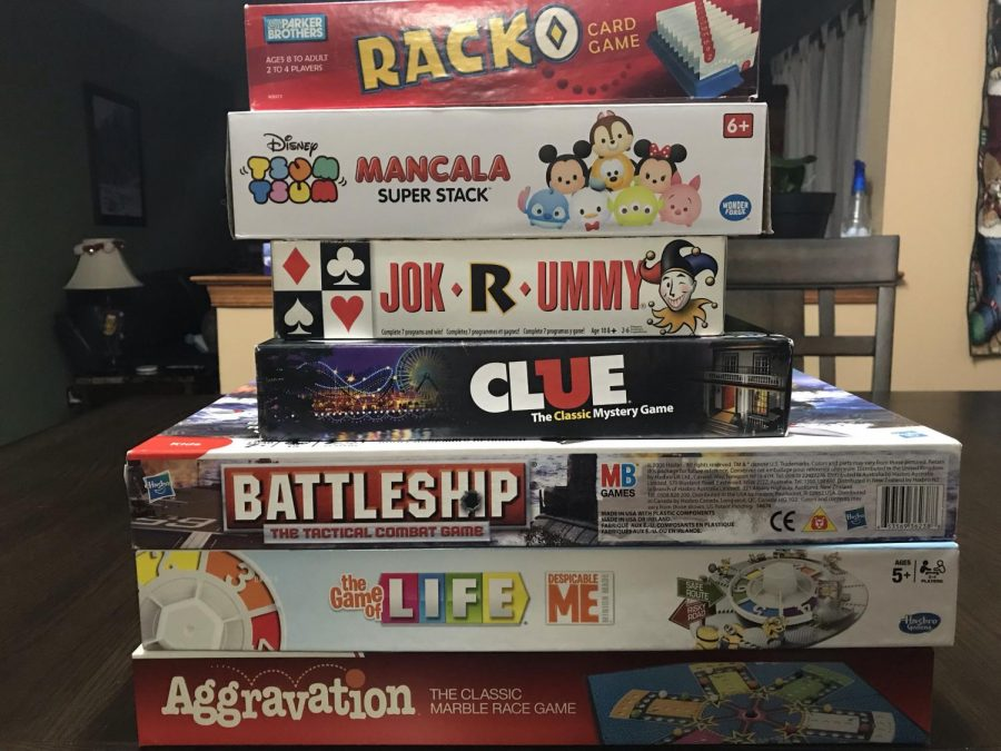 A stack of Brandi Marlin's most frustrating board games.