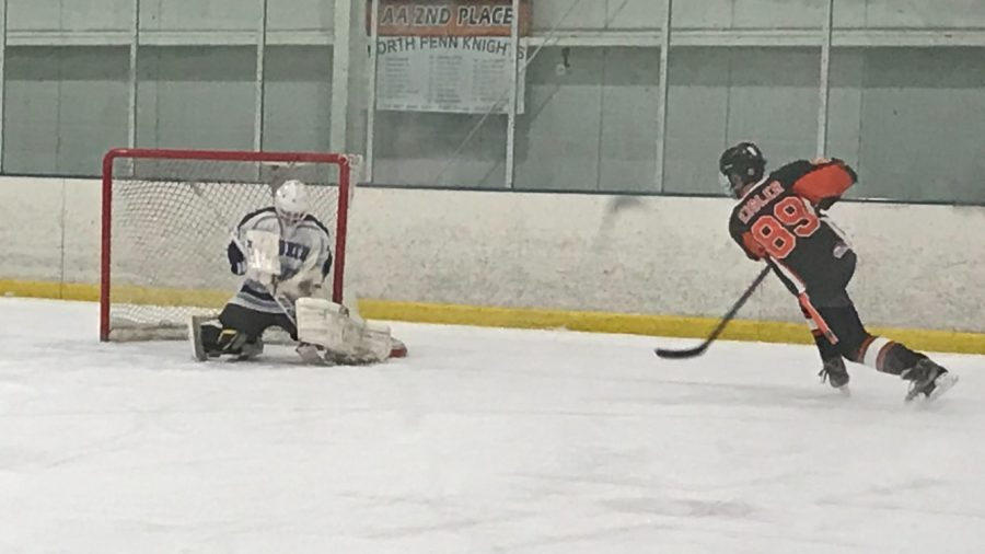 Freshman%2C+Nick+Ebbinghaus%2C+provides+another+brick+wall+effort+in+net+for+the+Knights+hockey+squad%2C+following+a+wrist+shot+by+Pennsbury%E2%80%99s+Erik+Eisler+