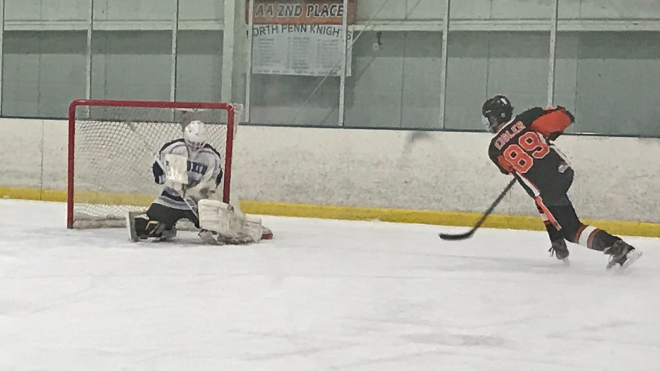 Freshman, Nick Ebbinghaus, provides another brick wall effort in net for the Knights hockey squad, following a wrist shot by Pennsbury's Erik Eisler