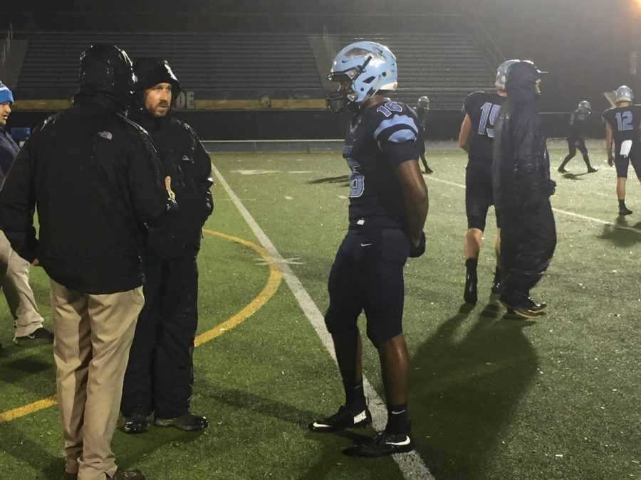 Defensive+Backs+Coach+David+Franek+talks+to+Evan+Spann+before+a+district+playoff+game.++Spann+had+a+critical+pick+six+near+the+end+of+the+game+that+helped+the+Knights+move+on+to+the+next+round.