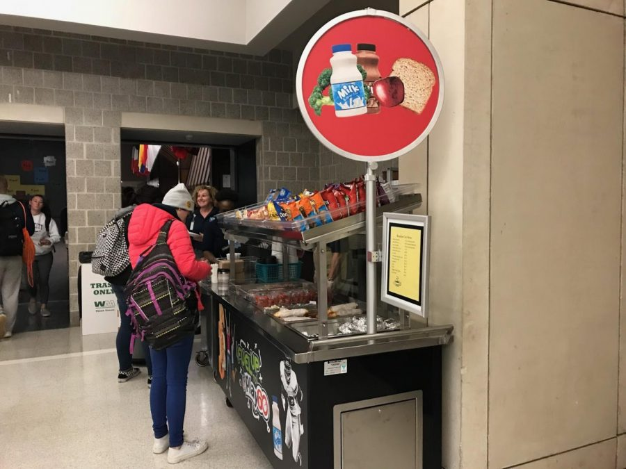 North Penn students wait in line to get breakfast at the new cart.