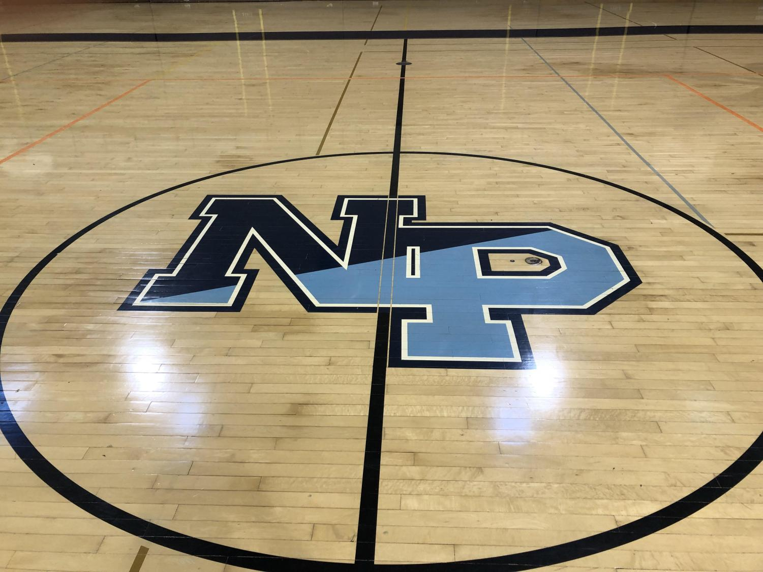 The North Penn logo located in the navy gym. Last year, the boy's and girl's gym were changed to the Navy and Columbia gym.