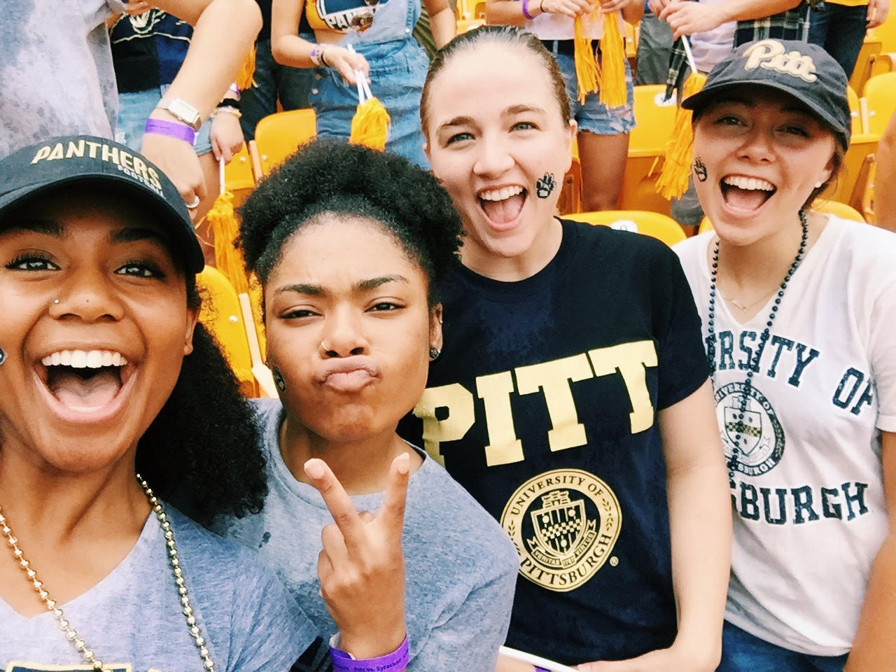 Morgan (far right) is thriving after high school in her junior year at Pitt.