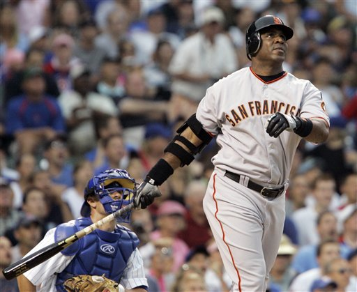 San Francisco Giants' Barry Bonds watches his home run during the second inning of a baseball game against the Chicago Cubs Thursday, July 19, 2007 in Chicago. It was his 752nd career home run.  (AP Photo/M. Spencer Green)