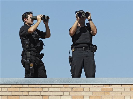 SWAT team members watch the crowd as President Barack Obama talks about his jobs bill at Lincoln High School in Denver, Tuesday, Sept. 27, 2011. (AP Photo/Ed Andrieski)