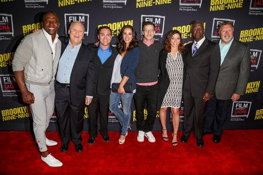 Terry Crews, from left, Dirk Blocker, Joe Lo Truglio, Melissa Fumero, Andy Samberg, Chelsea Peretti, Andre Braugher and Joel McKinnon Miller arrive at An Evening With