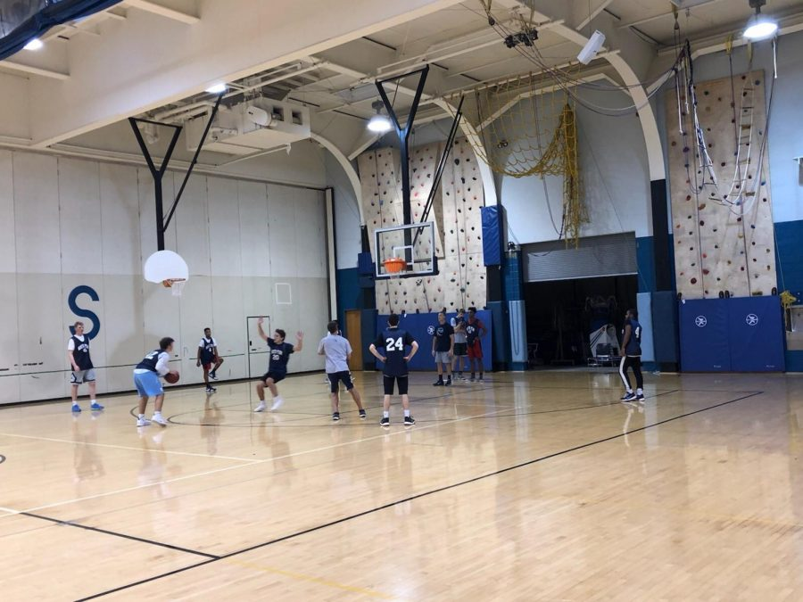 The boys' basketball team practices before their season gets underway