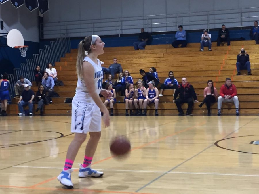 Sophomore+Alli+Lindsay+calls+out+a+play+as+she+dribbles+down+the+court.++She+would+lead+the+Knights+with+13+points.