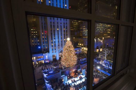 The Rockefeller Center Christmas tree is lit during the 86th annual Rockefeller Center Christmas tree lighting ceremony, Wednesday, Nov. 28, 2018, in New York. (AP Photo/Mary Altaffer)