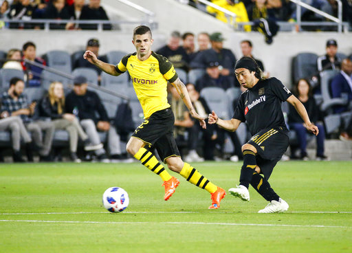 Los Angeles FC midfielder Lee Nguyen (24) and Borussia Dortmund midfielder Christian Pulisic (22) in actions during an international friendly soccer game between Los Angeles FC and Borussia Dortmund in Los Angeles, Tuesday, May 22, 2018. The game ended in a 1-1 draw. (AP Photo/Ringo H.W. Chiu)