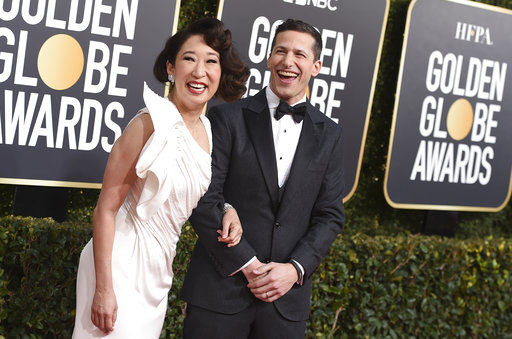 Hosts Sandra Oh, left, and Andy Samberg arrive at the 76th annual Golden Globe Awards at the Beverly Hilton Hotel on Sunday, Jan. 6, 2019, in Beverly Hills, Calif. (Photo by Jordan Strauss/Invision/AP)